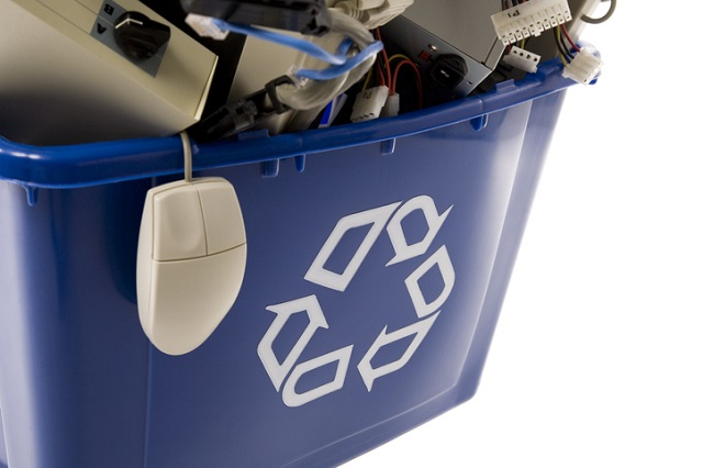 Computer parts in a recycling bin